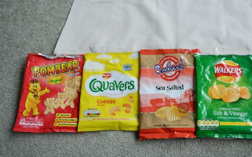 Sellotape crisp packets into place