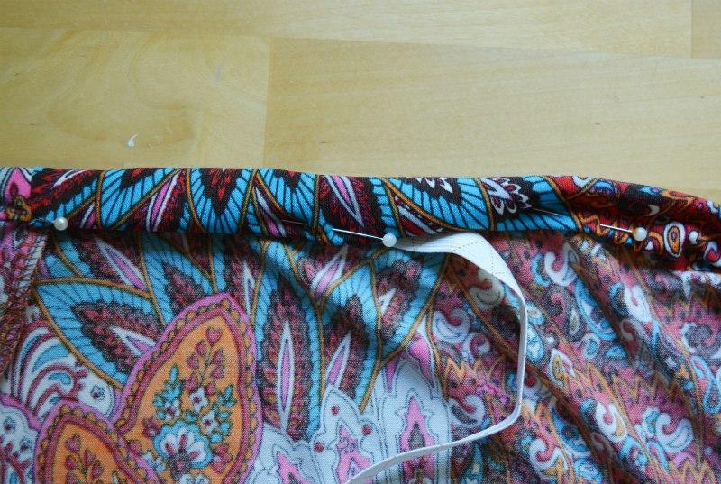 Insert elastic into oinned waistband