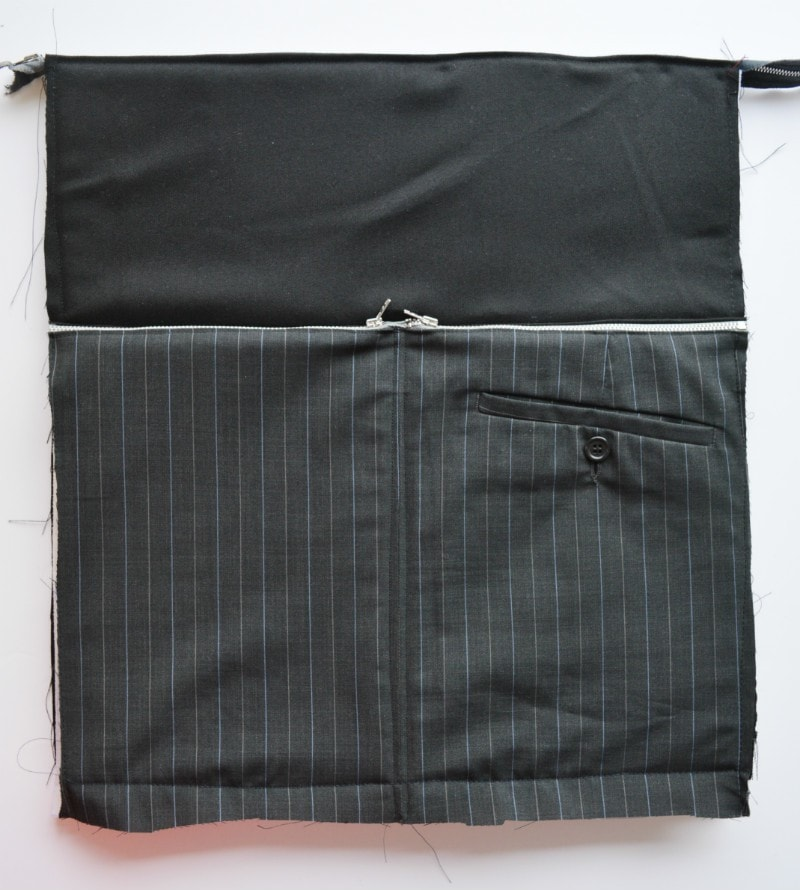 Suit trousers to create exteral zup pockets on bag