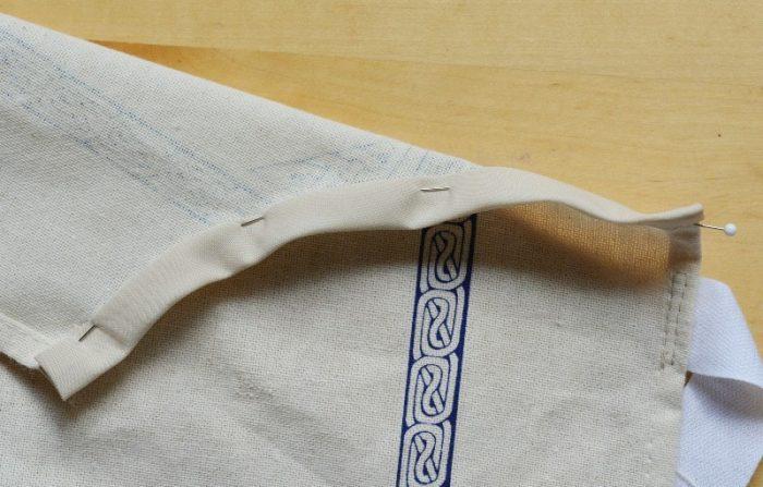Fold bias binding over and pin
