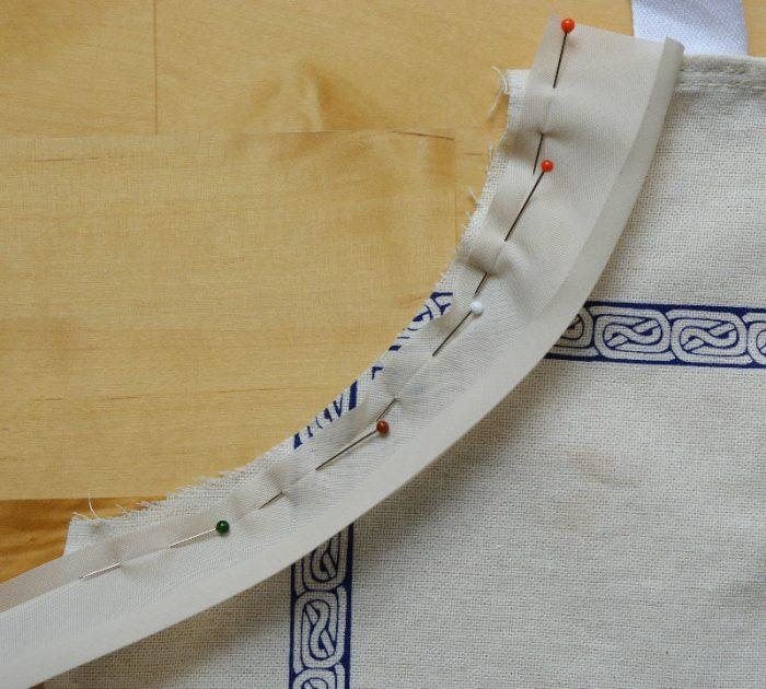 PIn bias binding to front of apron