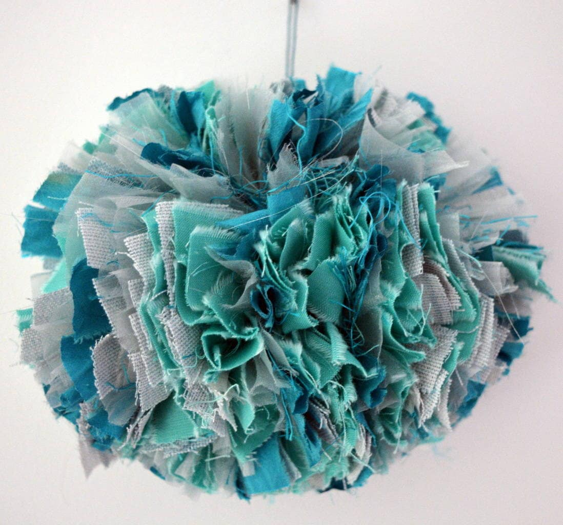 Large pompom created from fabric scraps