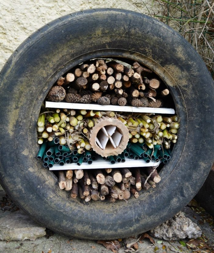 use-a-former-tyre-to-create-a-fun-diy-bug-hotel-hoe-to-make-your-own-but-hotel-on-the-blog