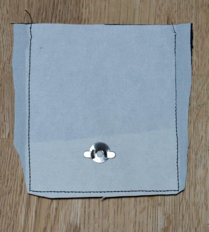 trim seams of fabric flap