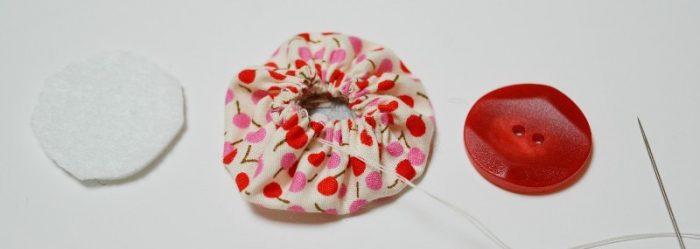 Gather fabric to create suffolk puff fabric flower
