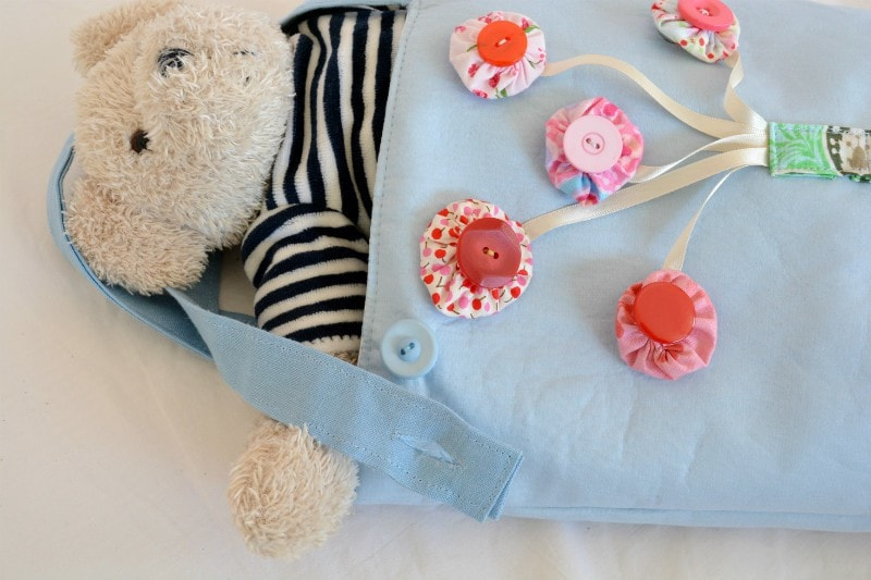 Busy Toddler Bag - button closure