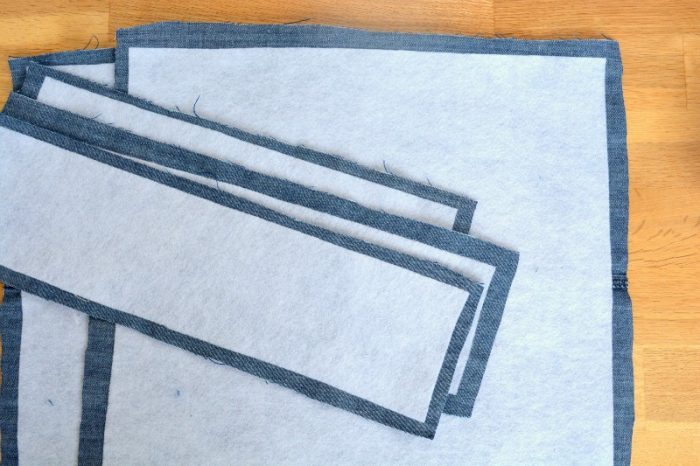 Fuse fuisible fleece to denim, trim fabric to include seam allowance