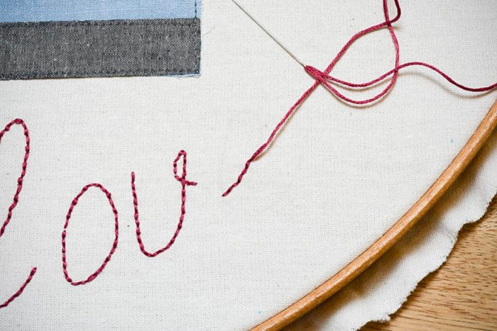hand embroider the letters_