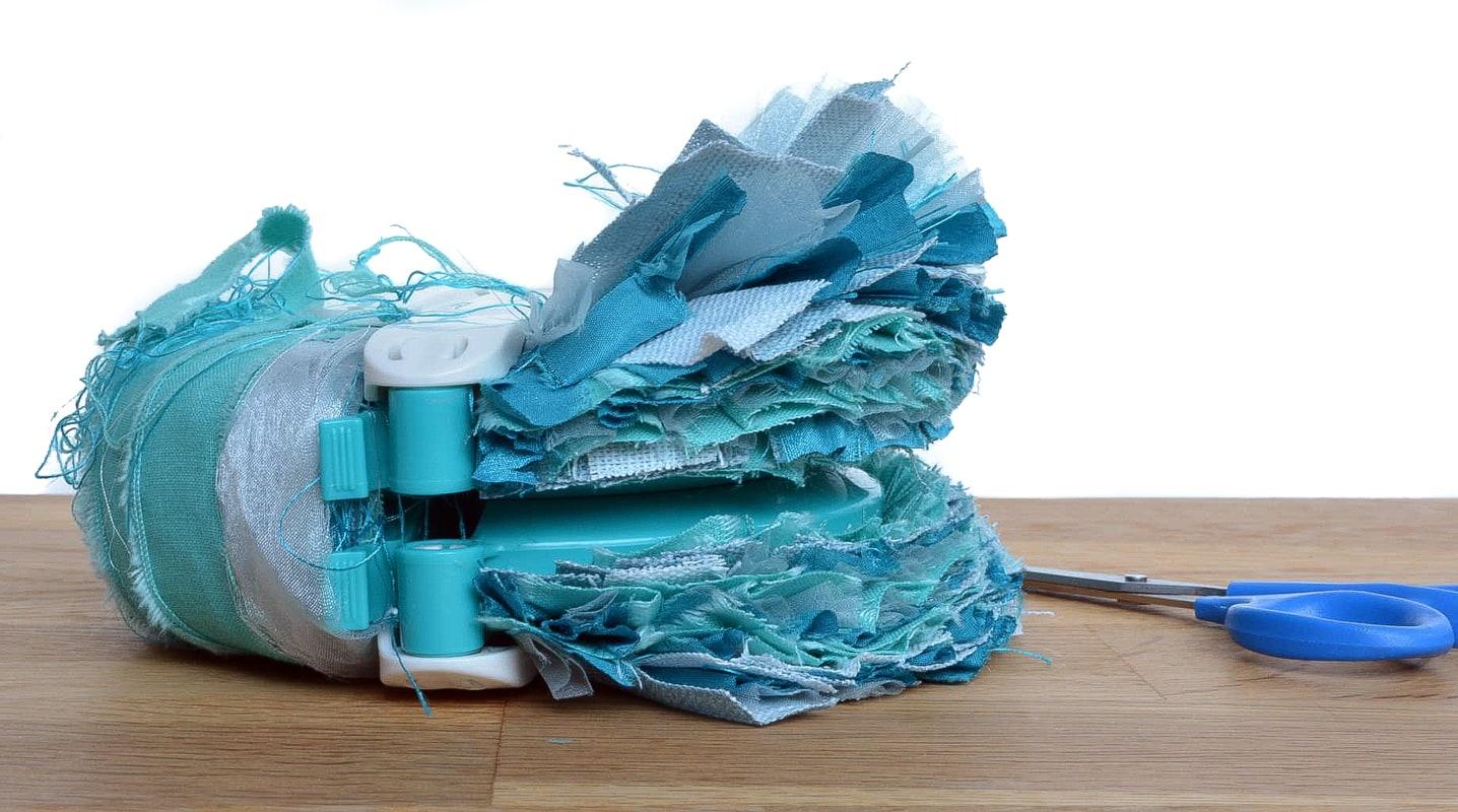 Large fabric scrap pom pom. DIY upcycled christmas decoration