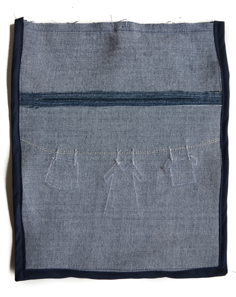 bias binding finishing seams of denim peg bag