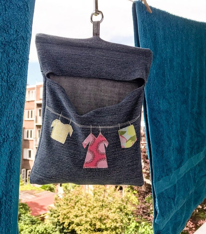Peg Bag hanging on washing line using key clip fob, denim peg bag pattern
