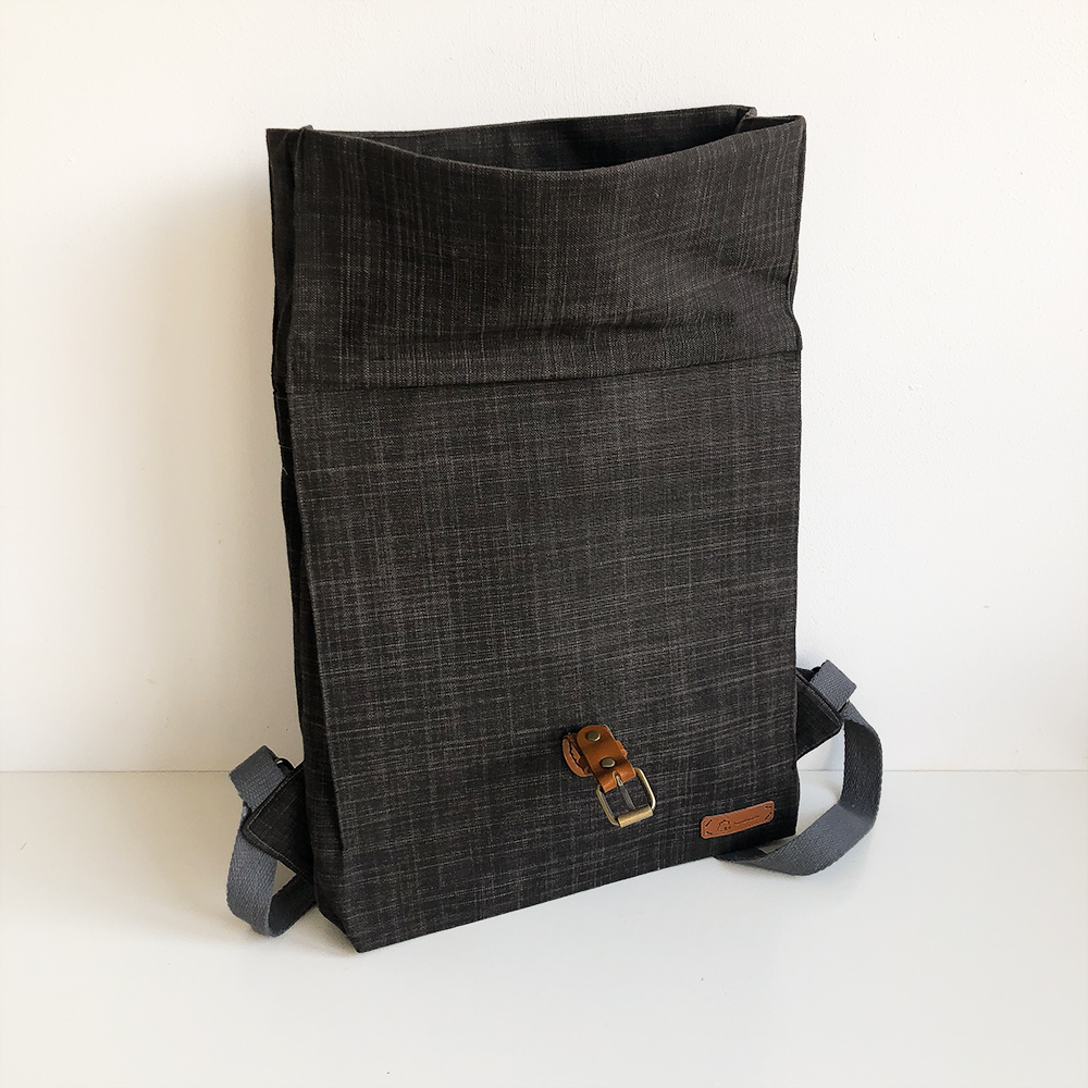Learn how easy it is to make this stylish DIY Backpack. A fabulous DIY mini backpack the construction draws on the design of a paper bag.